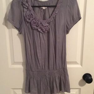 Grey top with flower on the left side of the neck